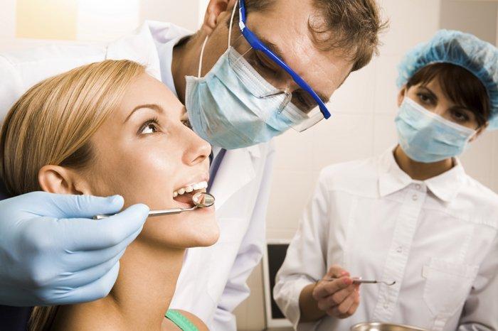 осмотр ротовой полости у стоматолога