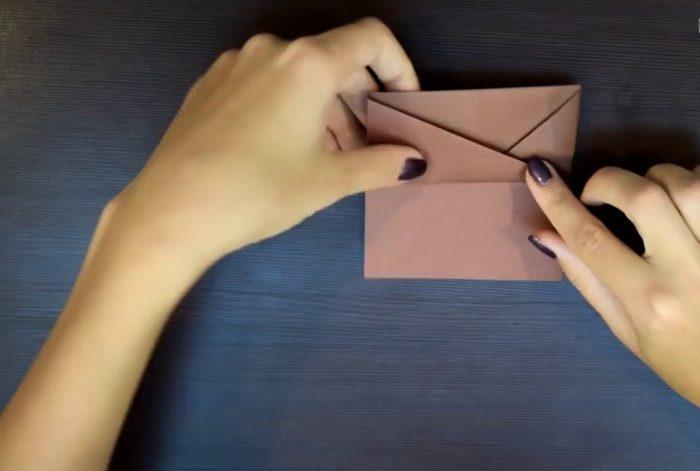 Изготовление собаки из бумаги оригами