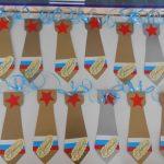 Галстуки из картона золотого и серебристого цвета с изображением красной звезды и флага России