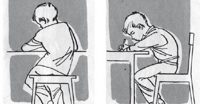 Мальчик перекашивает спину, сидя за столом; сидит согнувшись