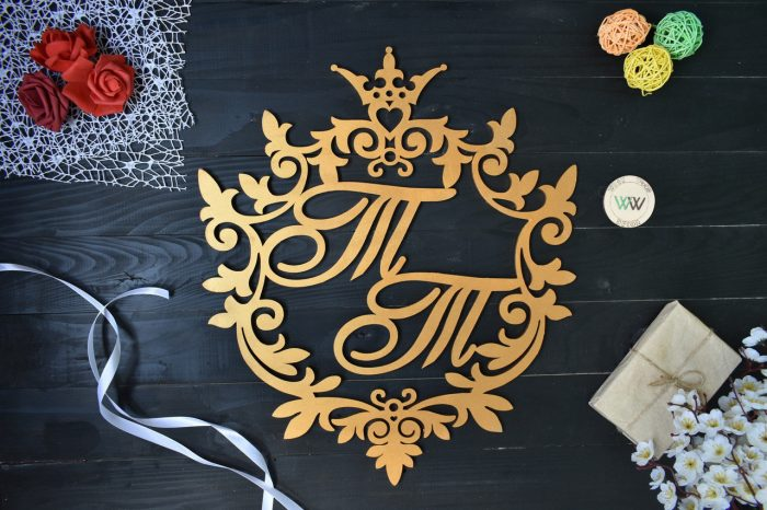 Герб семьи с двумя буками Т